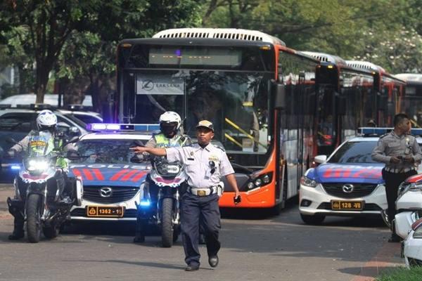 PENGAMANAN RUTE WISMA ATLET—VENUE  : Utak-Atik Trafik Demi Waktu Tempuh