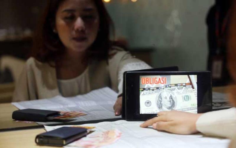PARTISIPASI ASING MENINGKAT   : Pasar Obligasi RI Bergairah