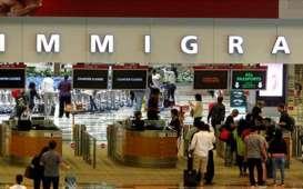 Mampu Tangani Corona, Singapura-Malaysia Perbolehkan Perjalanan Lintas Negara