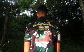 Foto-Foto Rutinitas Para Penjaga Perbatasan Indonesia-Malaysia di Jantung Borneo