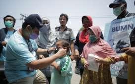 Tebar Masker, Pupuk Indonesia Ajak Masyarakat Disiplin Protokol Kesehatan