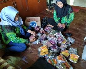 Pertamina Gandeng Mitra Binaan Produksi 1000 Masker untuk Korban Banjir Kalsel