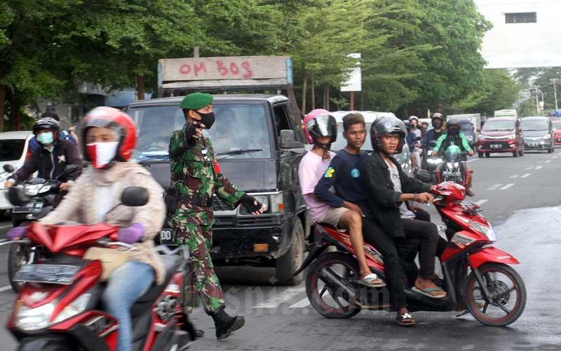 Razia Pengendara Motor Yang Tidak Menggunakan Masker di Makassar