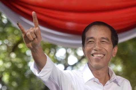 Capres RI 2014 Joko Widodo (Jokowi) saat  nyoblos dalam Pileg 2014 - JIBI