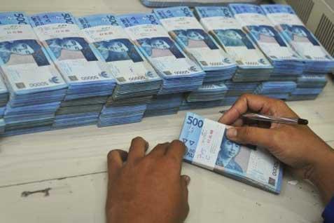 Ilustrasi uang rupiah. Pemerintah batasi dana pemda dalam bentuk deposito - JIBI