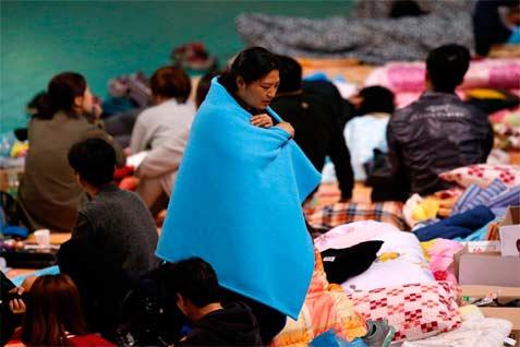 Keluarga korban Feri Sewol yang tenggelam  - Reuters