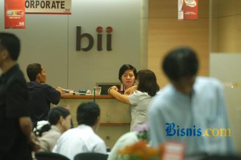 Counter bank BII. Kembali tak bagi dividen - Bisnis