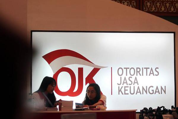OJK menilai rasio kredit bermasalah perbankan Indonesia masih berada pada posisi aman.  - Bisnis