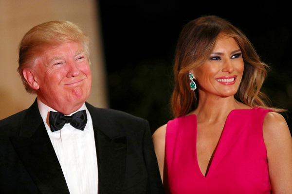 Presiden Amerika Serikat Donald Trump (kiri) dan Melania Trump. - REUTERS/Carlos Barria