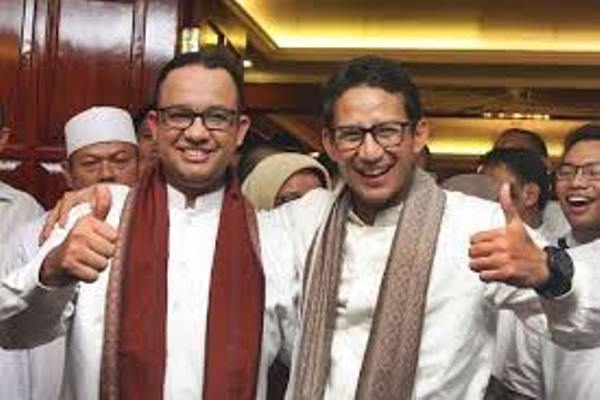 Anies Baswedan (kiri) dan Sandiaga Uno saat deklarasi pencalonan keduanya sebagai cagub dab cawagub DKI, Jumat (23/9/2016). - Antara/Reno Esnir