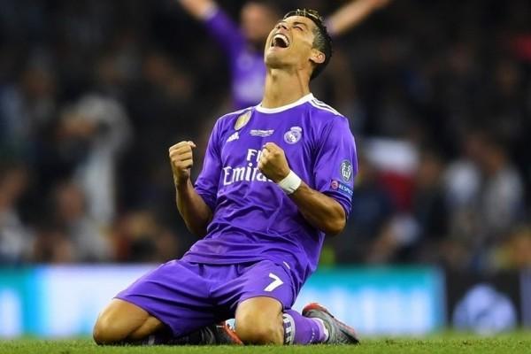 Cristiano Ronaldo merayakan keberhasilan Real Madrid menjuarai Liga Champions 2017 usai mengalahkan Juventus dengan skor 4-1 di Wales, Sabtu (3/6/17). - uefa.com