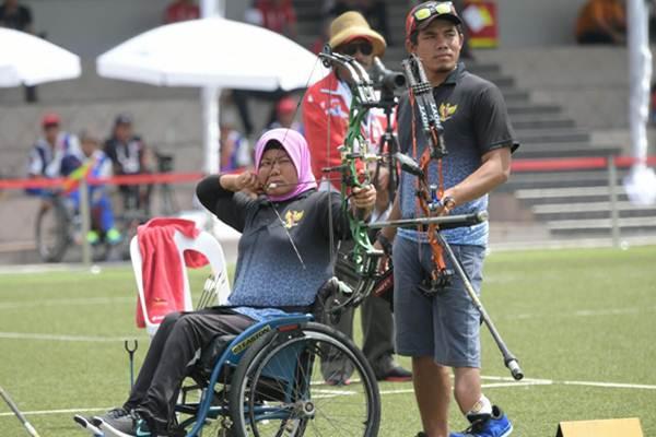 Ilustrasi: Atlet para panahan Indonesia dalam kompetisi di Asean Para Games Kuala Lumpur 2017. - Istimewa/Kemenpora