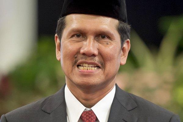 Menteri PAN dan Reformasi Birokrasi Asman Abnur mengikuti pelantikan di Istana Negara, Jakarta, Rabu (27/7). - Antara/Widodo S. Jusuf