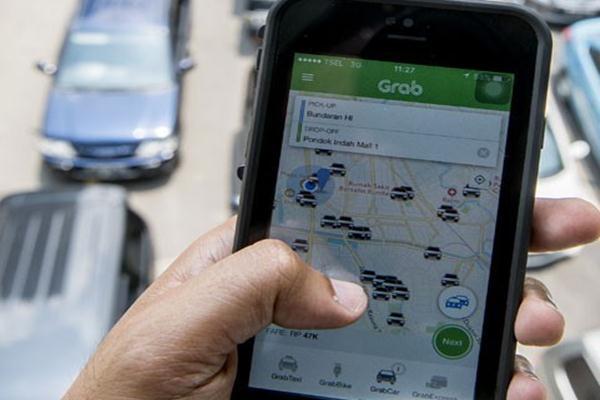 Aplikasi taksi daring, Grab - Antara