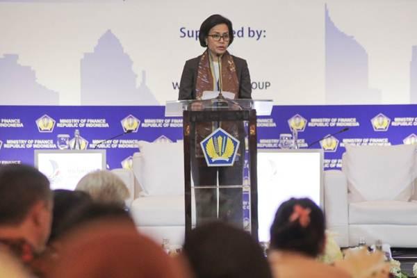 Menteri Keuangan Sri Mulyani menyampaikan keynote speech dalam seminar Managing Urbanisation for Sustainable Cities, di Jakarta, Selasa (19/12). - JIBI/Felix Jody Kinarwan