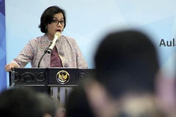 Menteri Keuangan Sri Mulyani memberikan keynote speech dalam acara Investor Gathering 2017 di Jakarta, Senin (18/12). - JIBI/Felix Jody Kinarwan