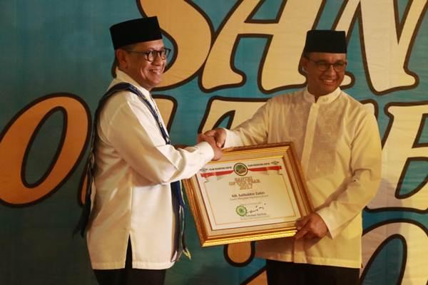Gubernur DKI Jakarta Anies Baswedan (kanan) - Istimewa/Kemenag