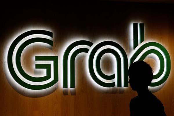 Logo angkutan online Grab - Reuters/Edgar Su