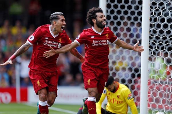 Dua ujung tombak Liverpool, Mohamed Salah (kanan) dan Roberto Firmino. - Reuters