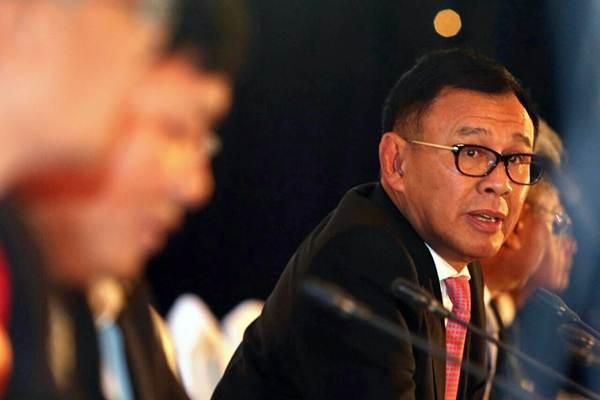 Direktur Utama PT Bank Negara Indonesia Tbk Achmad Baiquni (kanan) memberikan penjelasan mengenai kinerja perusahaan, seusai RUPS, di Jakarta, Selasa (20/3/2018). - JIBI/Dedi Gunawan