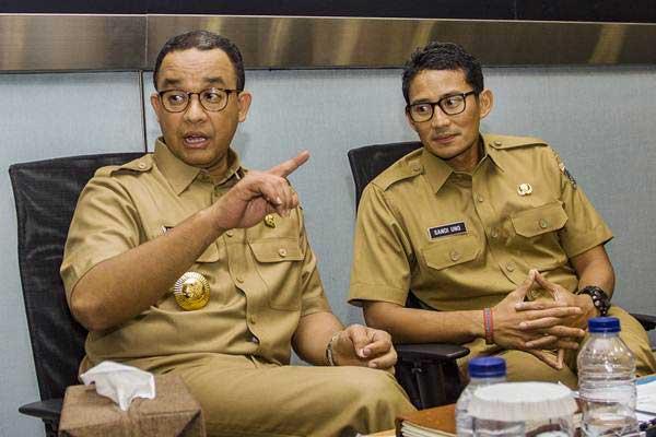 Gubernur DKI Jakarta Anies Baswedan (kiri) dan Wakil Gubernur DKI Jakarta Sandiaga Uno - ANTARA