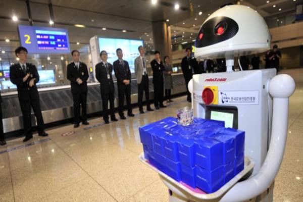 Robot-robot di Incheon Korea Selatan membantu para penumpang dan petugas. - Istimewa