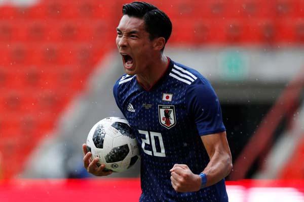 Bek tengah Timnas Jepang Tomoaki Makino setelah menjebol gawang Ukraina. Namun, akhirnya Jepang menyerah 1-2. - Reuters/Francois Lenoir