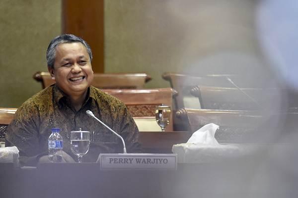 Calon Gubernur Bank Indonesia Perry Warjiyo bersiap menjalani uji kelayakan dan kepatutan di Komisi XI DPR, Kompleks Parlemen Senayan, Jakarta, Rabu (28/3/2018). - ANTARA/Puspa Perwitasari