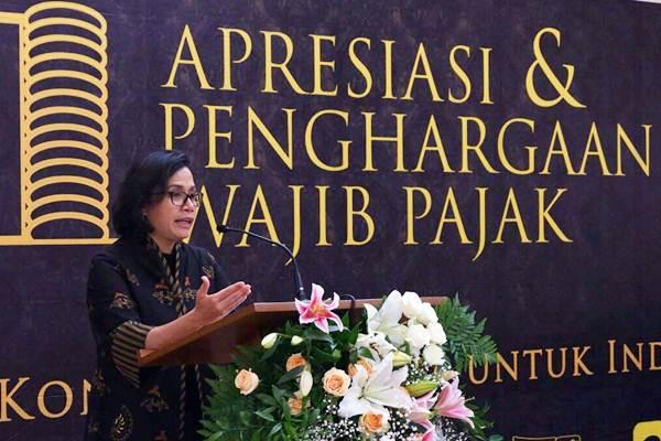 Menteri Keuangan Sri Mulyani memberikan kata sambutan di sela-sela pemberian penghargaan wajib pajak besar di Jakarta, Selasa (13/3/2018). - JIBI/Nurul Hidayat