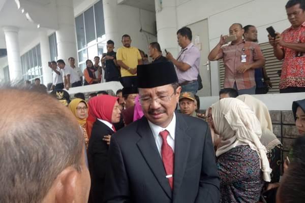 Tengku Erry Nuradi saat prosesi pelepasan dirinya sebagai gubernur Sumut. - Bisnis/Juli Etha