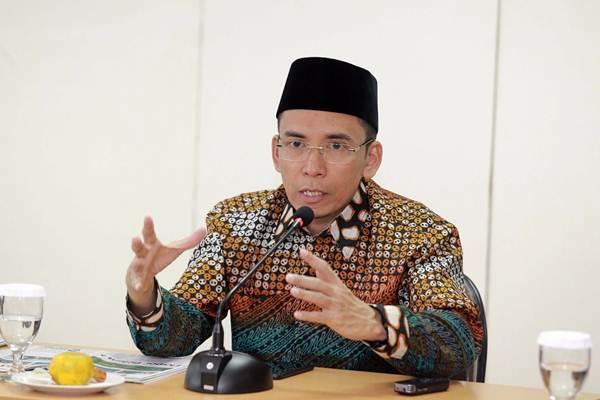 Gubernur Nusa Tenggara Barat Muhammad Zainul Majdi atau yang akrab disapa Tuan Guru Bajang (TGB), menjawab pertanyaan saat berkunjung ke Redaksi Bisnis Indonesia di Jakarta, Senin (9/7/2018). - JIBI/Dwi Prasetya