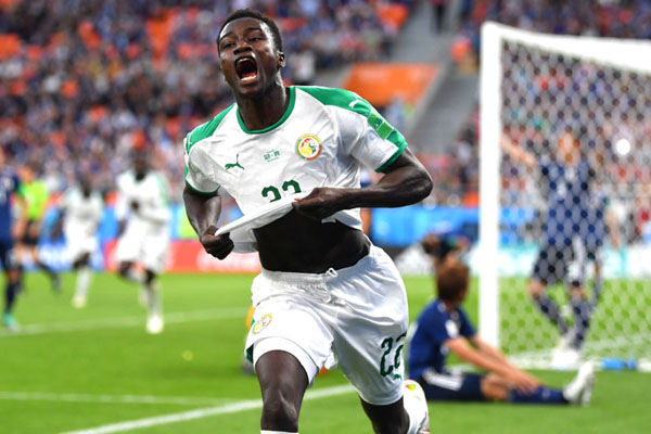 Moussa Wague setelah mencetak gol untuk Senegal ke gawang Jepang di Piala Dunia 2018. - Reuters
