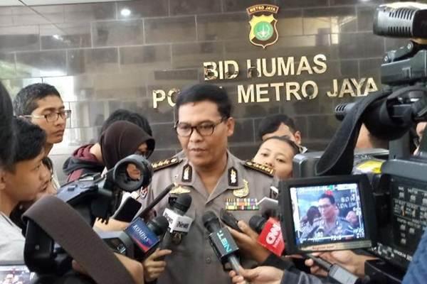 Kepala Bidang Humas Polda Metro Jaya Kombes Pol Raden Argo Yuwono sedang memberi keterangan kepada wartawan. - Bisnis/Sholahuddin Al Ayyubi