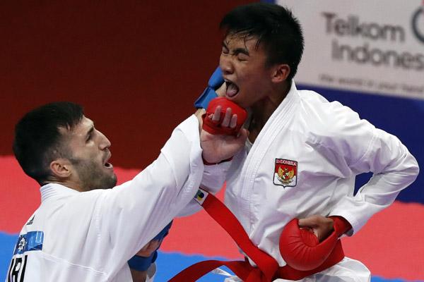 Karateka Indonesia, Rifki Ardiansyah Arrosyiid, meraih medali emas Asian Games 2018 di nomor Kumite 60 kilogram Minggu 26 Agustus 2018.Reuters / Issei Kato