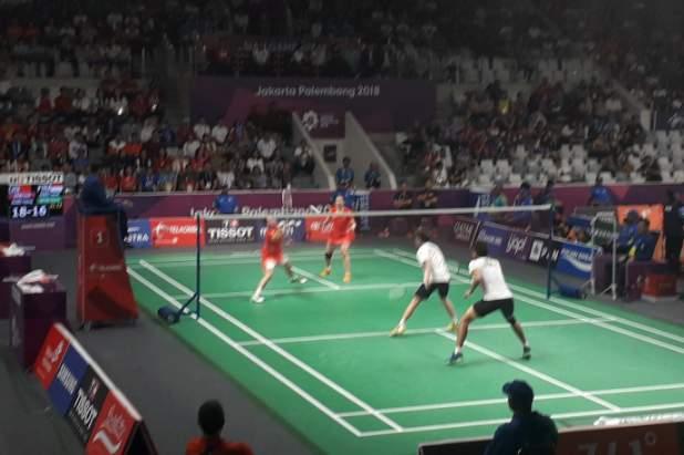 Pertandingan bulu tangkis Tontowi Ahmad-Liliyana Natsir vs Zheng Siwei-Huang Yaqiong - Bisnis.com/Andhika