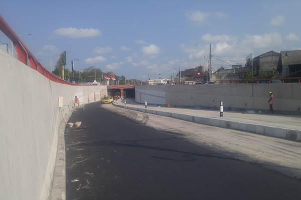 Proses pengerjaan Underpass Simpang Tugu Ngurah Rai, Senin (27/8/2018). - Bisnis/Ni Putu Eka Wiratmini