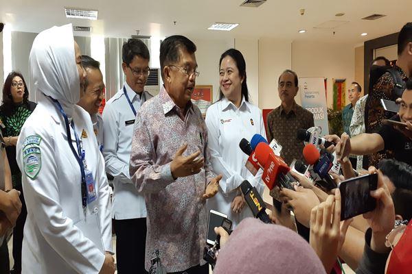Wakil Presiden Jusuf Kalla (tengah)./JIBI/BISNIS - Feni Freycinetia Fitriani