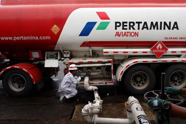 Pekerja beraktivitas di Depot Pengisian Pesawat Udara (DPPU) Halim Perdana Kusuma, Jakarta, Jumat (25/5/2018). - JIBI/Nurul Hidayat