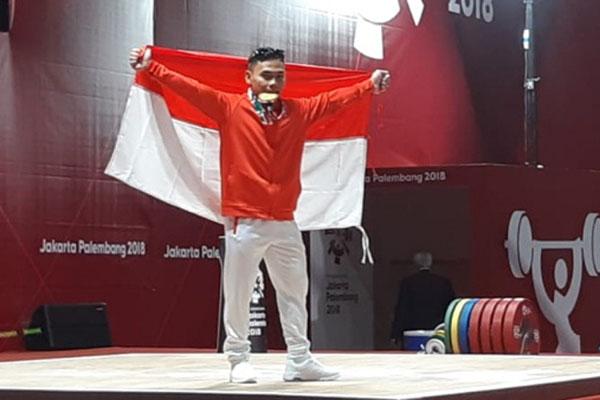 Lifter Indonesia Eko Yuli Irawan saat menjuarai angkat besi 62 kg Asian Games 2018 di Jakarta pada Selasa (21/8/2018). - Bisnis.com/Nur Faizah Al Bahriyatul Baqiroh