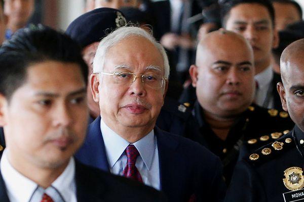 Mantan PM Malaysia Najib Razak tiba di pengadilan di Kuala Lumpur, Malaysia, Rabu (4/7). - Reuters/Lai Seng Sin