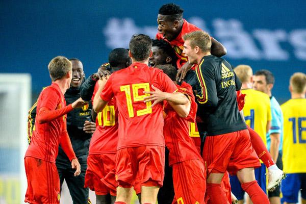Skuat Belgia bersuka cita selepas mencetak gol ke gawang Belanda. - Reuters