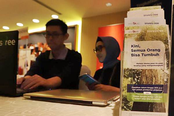 Karyawan melakukan aktivitas di salah satu perusahaan financial technology (Fintech), di Jakarta, Selasa (3/4/2018). - JIBI/Endang Muchtar