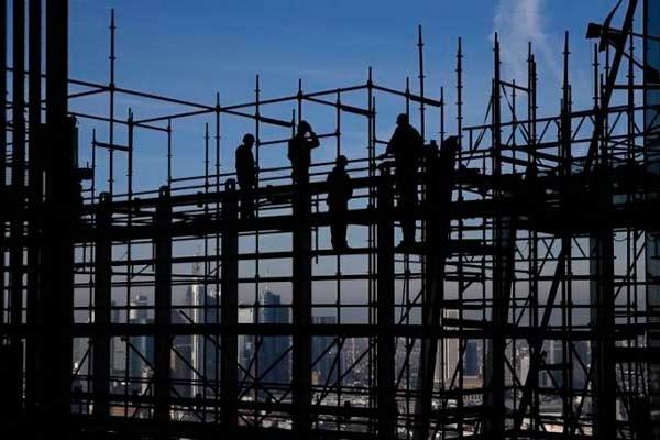 Pekerja konstruksi.  - Reuters