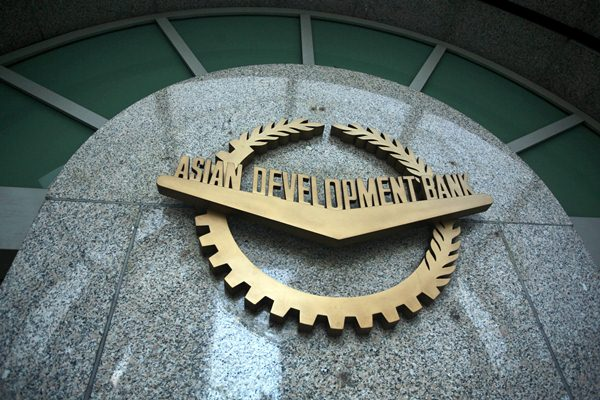 Logo Asian Development Bank (ADB). - Bloomberg/Nana Buxani