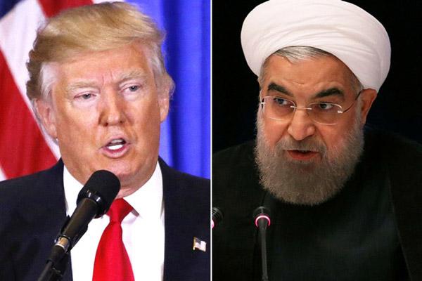 Presiden Iran Hassan Rouhani (kanan) dan Presiden AS Donald Trump. - Reuters