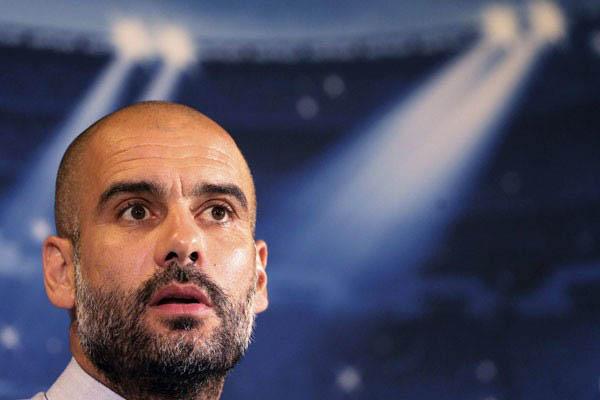 Pelatih Manchester City Pep Guardiola - Reuters/Alessandro Bianchi