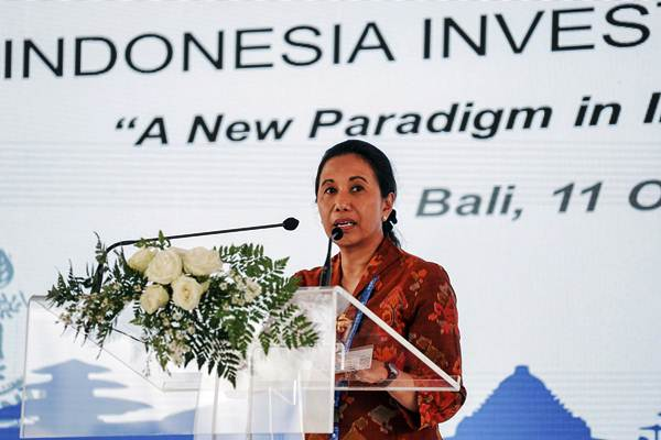 Menteri BUMN Rini Soemarno menyampaikan sambutannya pada acara penandatanganan Kerja sama Kesepakatan Investasi untuk Pembiayaan Infrastruktur di Hotel Inaya, Nusa Dua, Bali, Kamis (11/10/2018). - ANTARA/Jefri Tarigan
