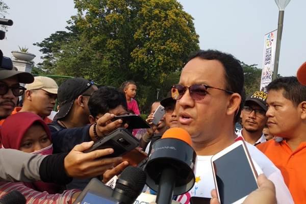 Gubernur DKI Jakarta Anies Baswedan usai menghadiri Parade Momo di Pintu Tenggara Monumen Nasional, Gambir, Jakarta Pusat, Minggu (23/9/2018). - Bisnis/Nur Faizah