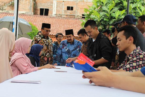 Suasana pencairan Program Keluarga Harapan di Kabupaten Cianjur. Kabupaten Cianjur mendapatkan bansos PKH lebih dari Rp255 miliar. - Istimewa