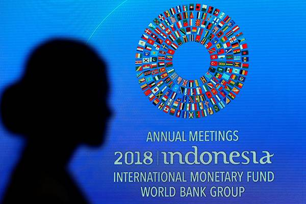 Peserta saat mengikuti salah satu acara dalam rangkaian Pertemuan IMF  World Bank Group 2018, di Nusa Dua, Bali, Jumat (12/10/2018). - Reuters/Johannes P. Christo
